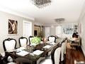 餐厅:98平的空间里辟出8人位的餐桌,适合家庭聚会,风格也很简单大气  装修方式:轻工辅料 装修造价:2.5万 装修单位:淘青岛装修 设计说明:本案的设计风格为简欧风格,营造典雅、自然、高贵的气质、浪漫的情调 是本案的主题。